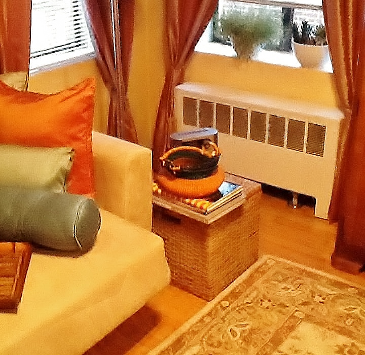 Create a Zen and serene living room by using a soft wall color, neutral furniture. Add drama with a vibrant patterned rug, art and pillows.